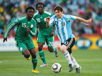 Nigeria's-Haruna-Lukman-left-competing-with-Argentina's-Lionel-Messi-during-their-match-at-the-2010-World-Cup-in-South-Africa