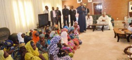 Governor Shetttima (sitting right ), Pastor Pona (speaking) and the Chibok girls...Wed.24th, 2014