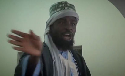B'Haram parades and preaches to residents of captured town, denies ceasefire in new video