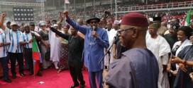 APC Presidential Candidate Muhammadu Buhari acknowledging cheers from supporters at Adokiye Amieseimeka Stadium, Port Harcourt