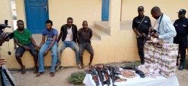 The arrested suspected robbers that attacked banks in Ikirun, Osun State being paraded with their loot