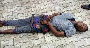 The kidnapper after being arrested by policemen