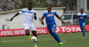 Enyimba FC player battle with Rayon Sport player in the field of play